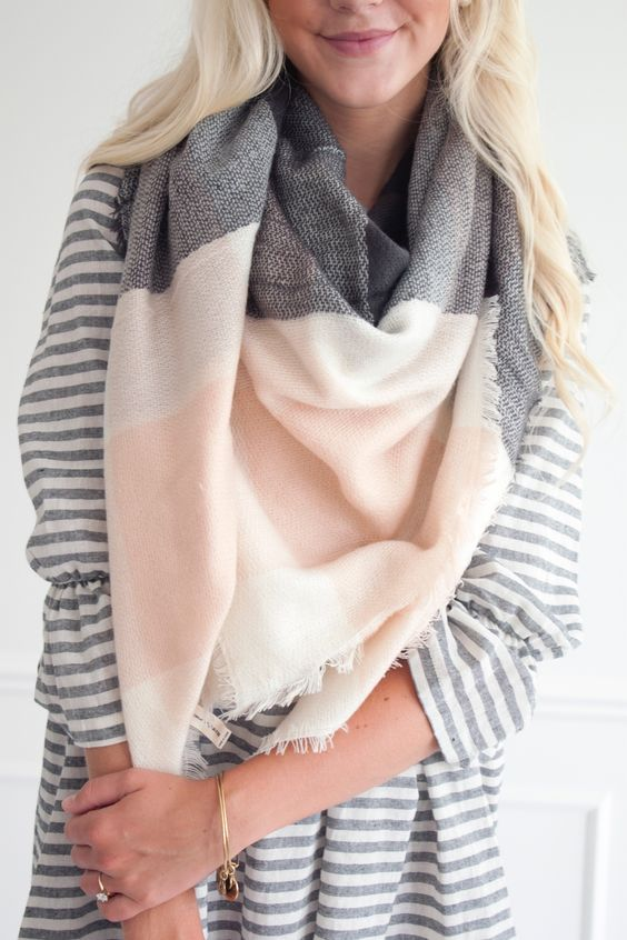 multi-colored scarf, pink scarf, gray scarf, gray stripped shirt