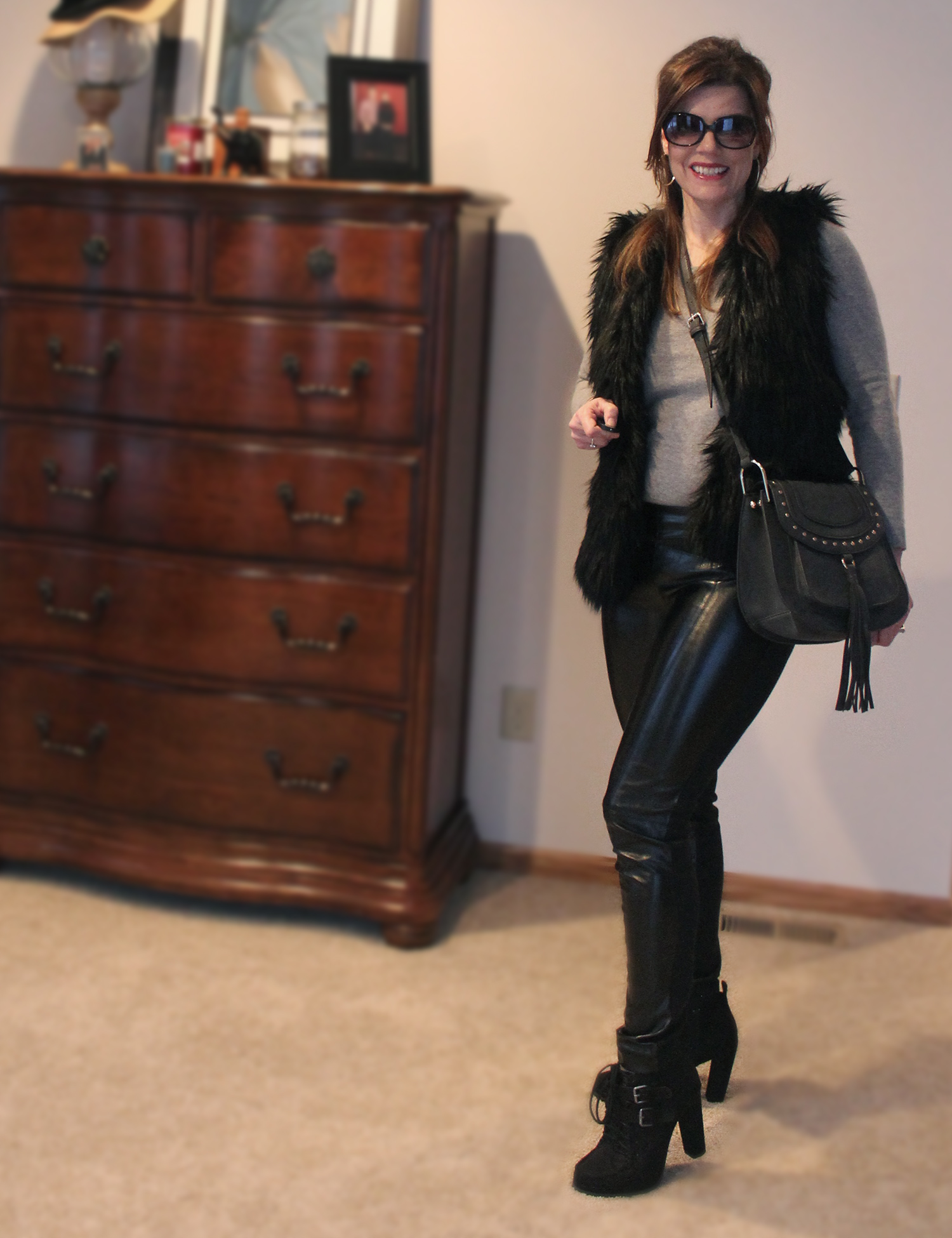 winter outfit, black leather outfit, fur vest, cool girl