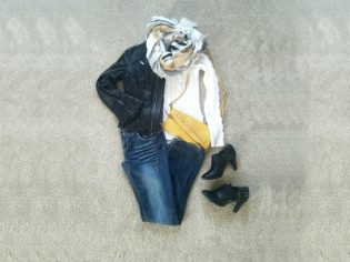 jeans, black leather jacket, yellow bag, black booties, white sweater, yellow and gray scarf